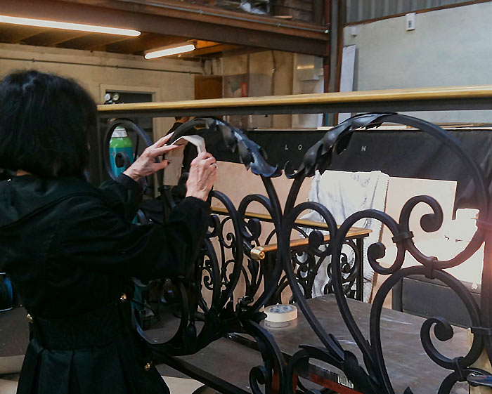 "The client adds cardboard acanthus to the ""as drawn"" balustrades."