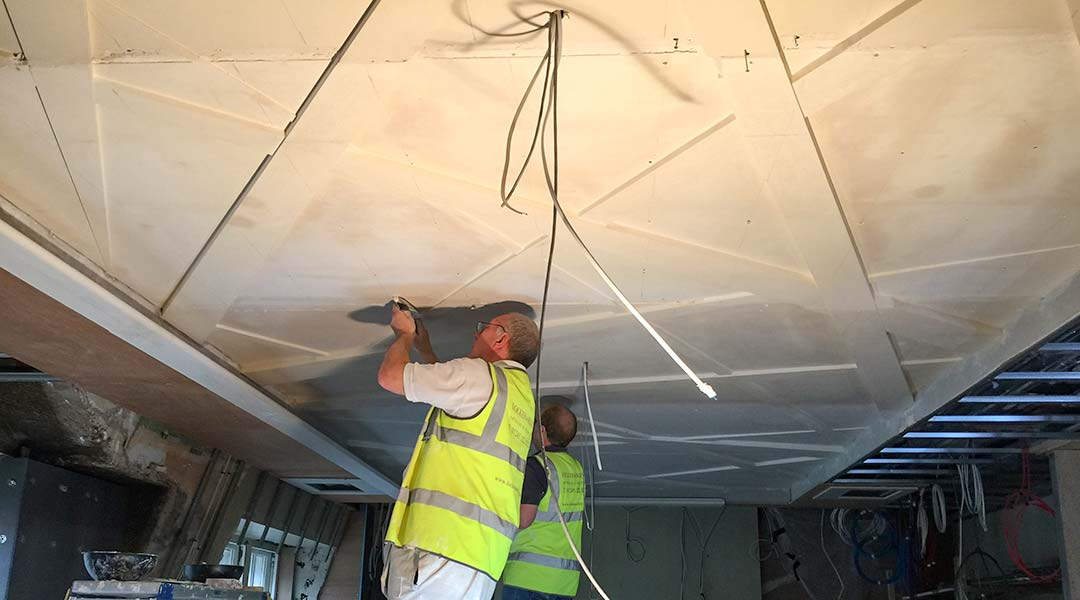 L&R specialists installing and filling the final ceiling.